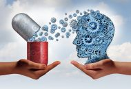 Brain medicine mental health care concept as hands holding an open pill capsule releasing gears to a human head made of machine cog wheels as a symbol for the pharmaceutical science of neurology and the treatment of psychological illness.