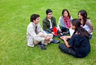 BHA19A Group of students sitting in a circle outdoors